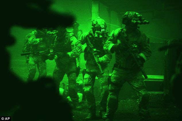 On film: The shooting was featured in movie Zero Dark Thirty, including this scene showing Navy SEALs seen through the greenish glow of night vision goggles, as they prepare to breach Osama Bin Laden's compound
