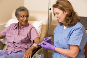 Photo of a nurse injecting a patient