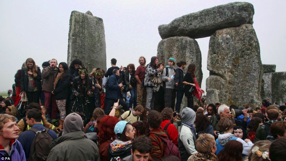 Crowds were still celebrating the solstice at dawn despite keeping vigil overnight at Stonehenge