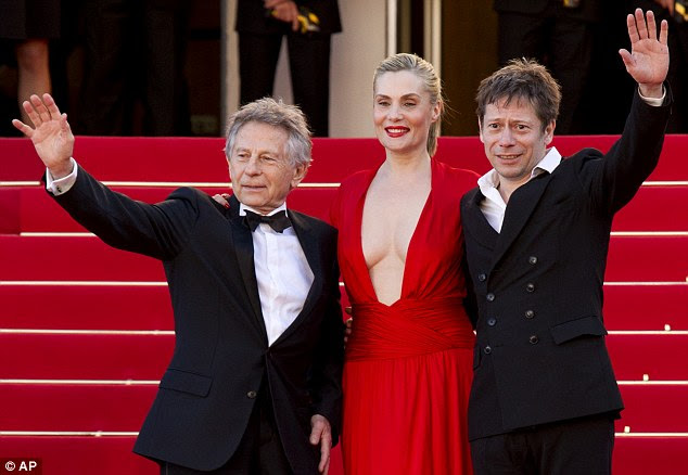 High-profile event: The filmmaker (left) made the comments at the Cannes Film Festival, where he came with his wife, actress Emmanuelle Seigner (center), and her co-star Mathieu Amalric (right) to premiere Venus in Fur
