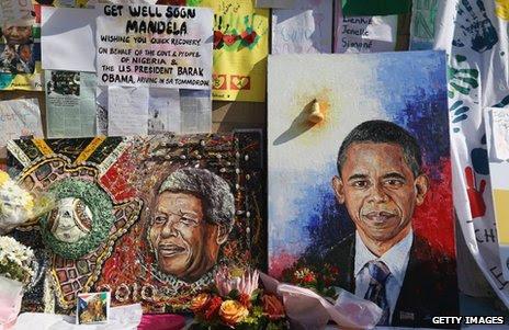 Portraits of Nelson Mandela (left) and Barack Obama outside the MediClinic Heart hospital in Pretoria, 29 June