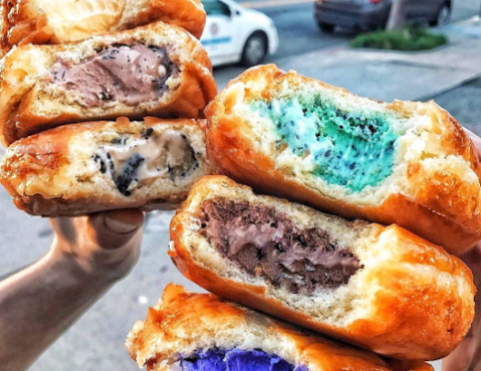 Someone has created an ice-cream filled donut and we are in LOVE