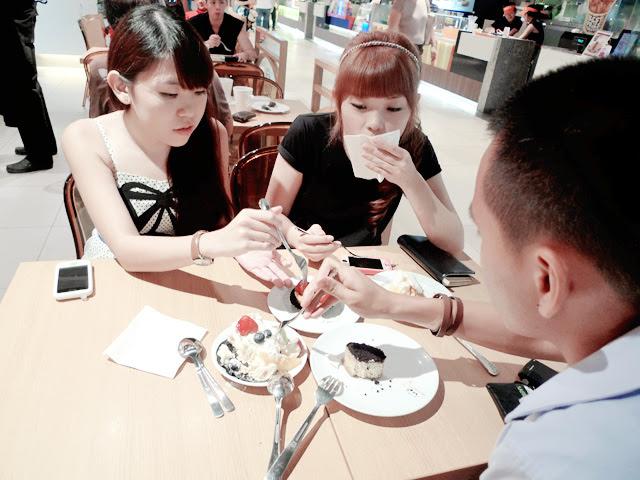 fingers eating desserts