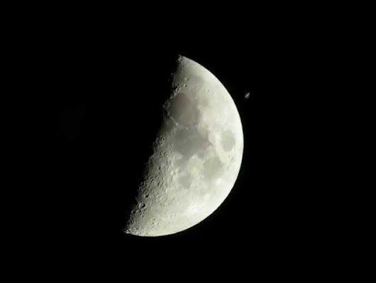 Watch The Space Station Go Flying Past The Moon