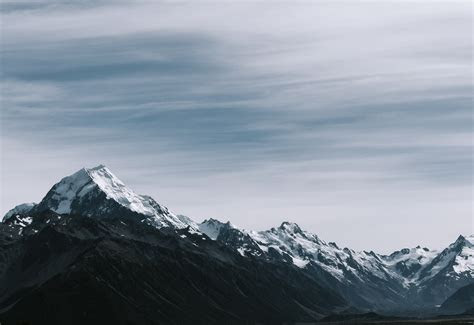 snow coated rocky mountains  stock photo