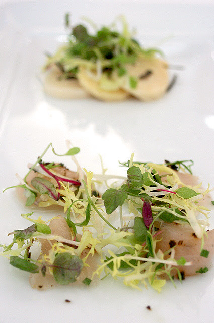 Ceviche of 'Buri-OH' marinated in lemon dressing (foreground); Steamed bamboo Shoots in Truffle Dressing with Micro Greens