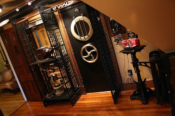 I have a complex layout for a mechanized door-barring system for my eventual vardo; I can't find anything similar, but this is so beautiful I just could not resist posting it. From The Modern Victorian Steampunk Home.
