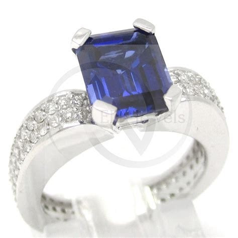 Emerald Cut Blue Sapphire & Diamonds Engagement Ring