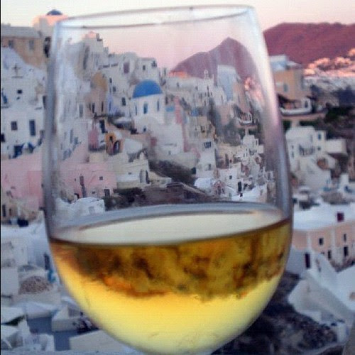 {Day 20} one of my #favoritephotosevertaken ...Oia through my wine glass #junephotoaday #nofilter