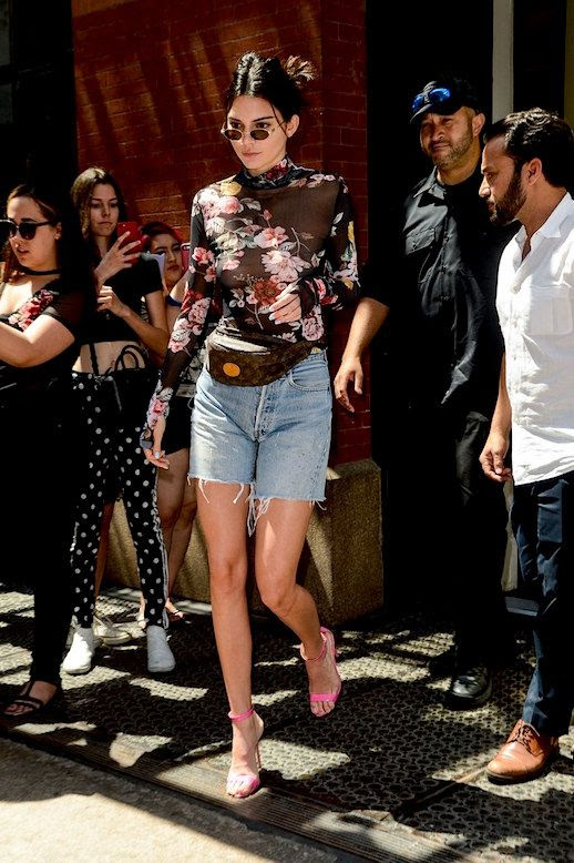 Le Fashion Blog Kendall Jenner Floral Sheer Blouse Denim Shorts Fanny Pack Pink Heels Via Vogue