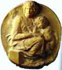 Michelangelo. Tondo Pitti - Virgin and Child with the Young St. John.