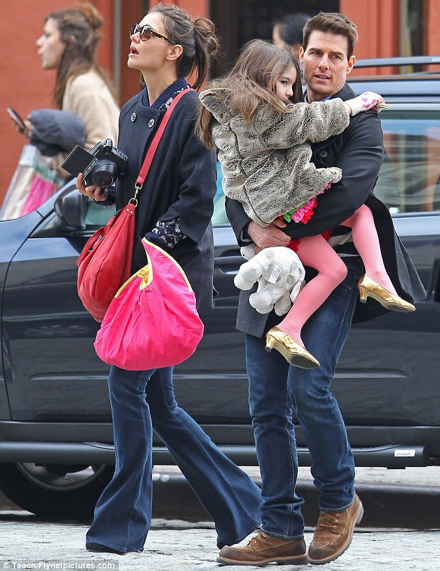 Family man: Tom and Katie, pictured in December, have six-year-old daughter Suri together