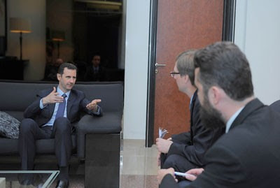 Syrian President Bashar al-Assad in interview with Izvestia news agency. A new round of provocations have been carried out against Syria. by Pan-African News Wire File Photos