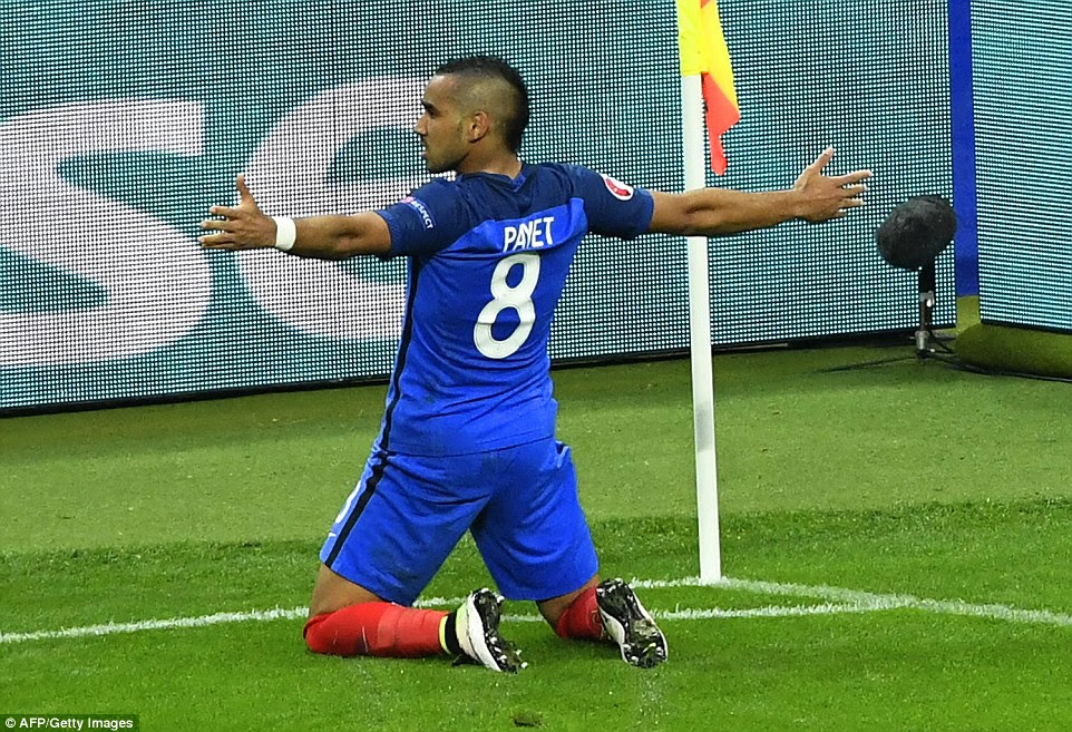 The 29-year-old slides on his knees as France continued to rack up the goals in a dominant first-half display