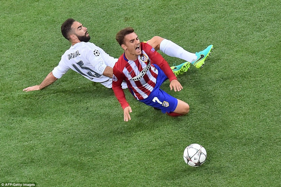 Real Madrid's Spanish defender Dani Carvajal was the first in Mark Clattenburg's note book after cynically taking out Antoine Griezmann