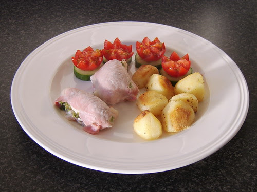 Chicken Breast Wrapped in Bacon with Roast Potatoes and Cucumber and Tomato