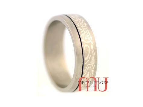 Mokume Gane and titanium wedding ring with blue groove