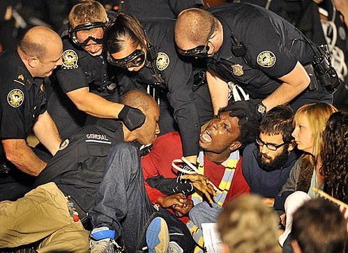 Atlanta cops remove activists from Occupy Atlanta who had set up in a park for several days. The Occupy movement has spread throughout North America and around the world.  by Pan-African News Wire File Photos
