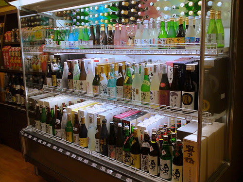 Small to large bottles of sake, chilled
