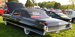 1962 Cadillac Series 62 with rear wheels covered by detachable Fender Skirts