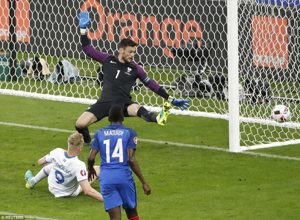 Sigthorsson watches on as his finish beats France goalkeeper Hugo Lloris to reduce the scoreline to 4-1 on 56 minutes