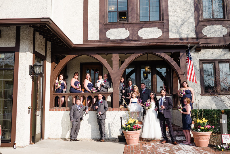 Photos with the Bridesmaids and Groomsmen at the University Club in downtown Rockford IL on a beautiful spring day.
