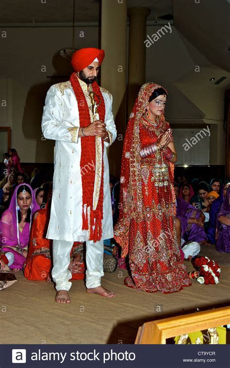 Traditional East Indian Sikh wedding groom bright red