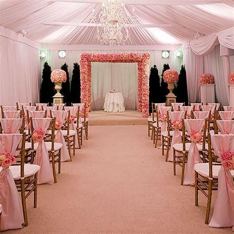 Gold chiavari chairs and light pink sashes. Beautiful