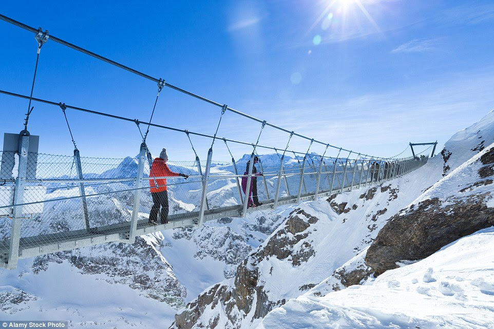 The Titlis Cliff Walk in Switzerland hangs 9842 ft above sea level and offers mountainous views - and sweaty palms - for those willing to travel across it
