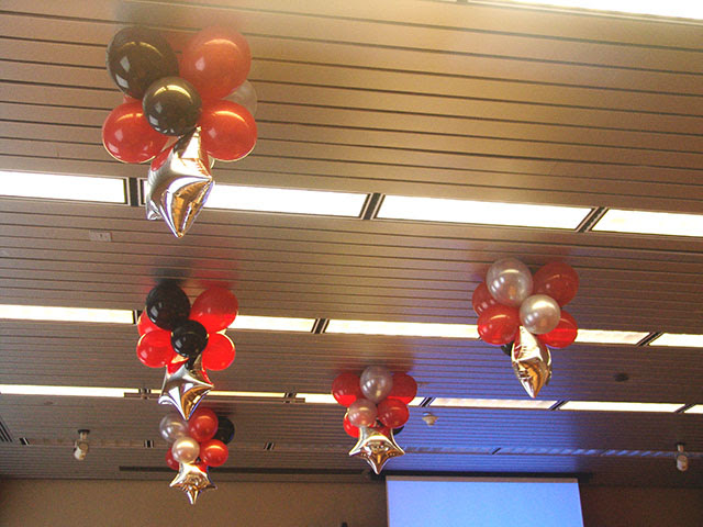 Here we used balloon columns and balloon ceiling centerpieces to punch