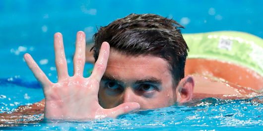 Michael Phelps is going to race a shark