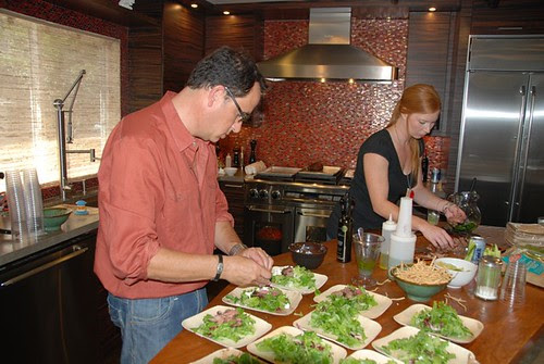 sam the cooking guy and his assistant, Erin prepping steak salad