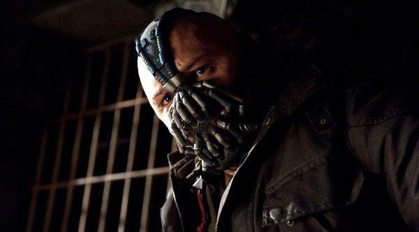 Bane stares menacingly at his off-screen victim (Bruce Wayne?) in THE DARK KNIGHT RISES.