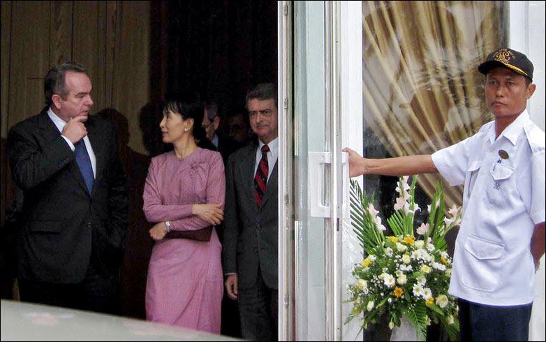 Detained Burmese opposition leader Aung San Suu Kyi talks with two senior American envoys