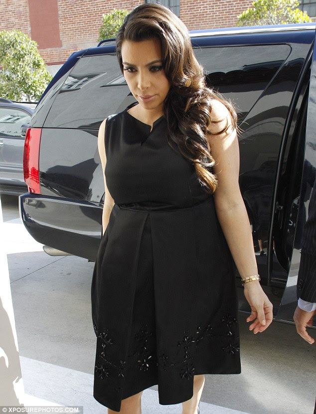 Sombre: Kim was classy enough to wear black and not look too pleased about the whole debacle