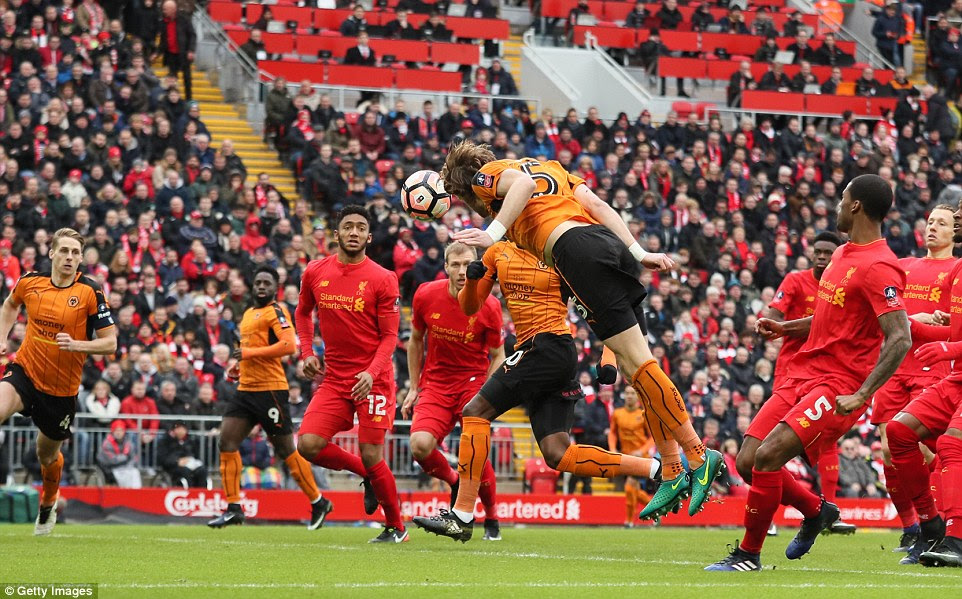 Richard Stearman steers the ball past Karius with his head to give Wolves a first-minute lead at Anfield