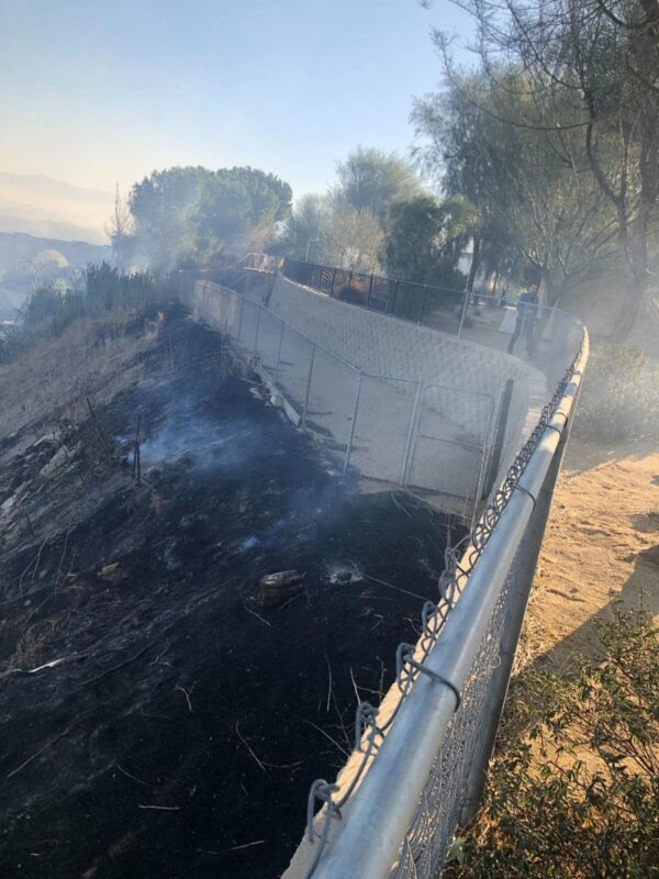 """""""The charred and burning ground reached all the way up the fences of our play-yard and our Clinic, only a few feet away from our building,"""" says the email the Mary S. Roberts Pet Adoption Center in Riverside, California, sent out to its volunteers. Courtesy PAC."""