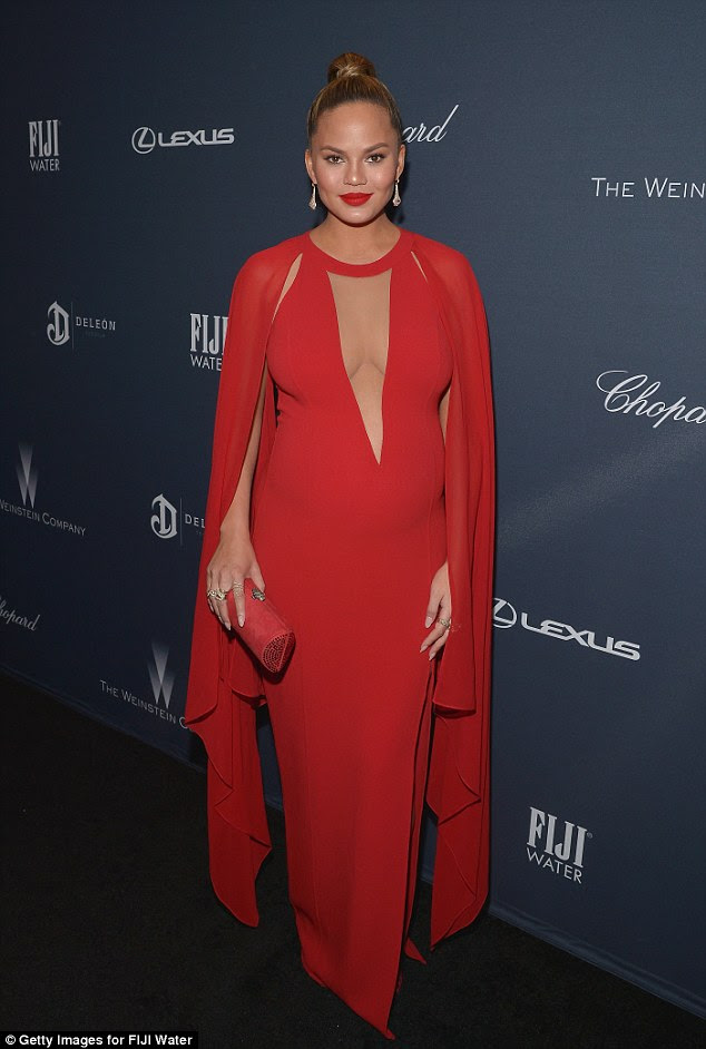 Dip it low:The dramatic gown featured a plunging neckline that finished up mid-bump and showed off the Sport's Illustrated star's cleavage