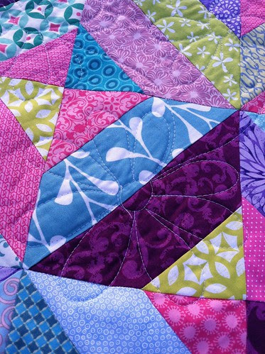 An upclose of the quilting...can't believe it didn't get that string off...