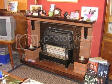 Photo by Rullsenberg: old front room fireplace made of crud