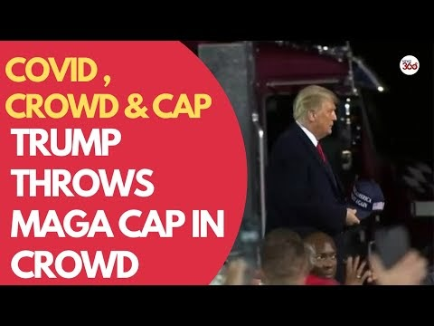 Trump throws MAGA cap in crowd before announcing he had COVID-19 | COVID...
