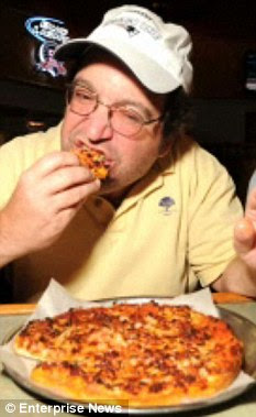 Yummy: David munches on one of his favourite pizzas
