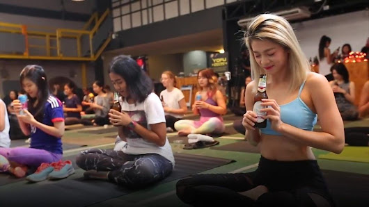 Have you got the bottle for 'beer yoga'? - BBC News