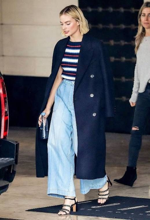 Le Fashion Blog Margot Robbie Spring Look Navy Blue Long Coat Striped Sweater Wide Leg Denim Cropped Pants Embellished Heeled Sandals Via Who What Wear