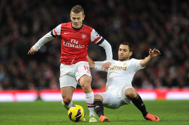 Rested for Euro trip: Arsenal's Jack Wilshere (L) in action with Swansea's Itay Shechter
