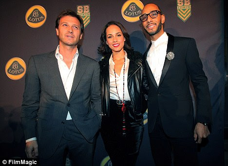 Friends: Dany Bahar, left, with singer Alicia Keys and her husband, rapper Swizz Beatz, who was given a job with Lotus