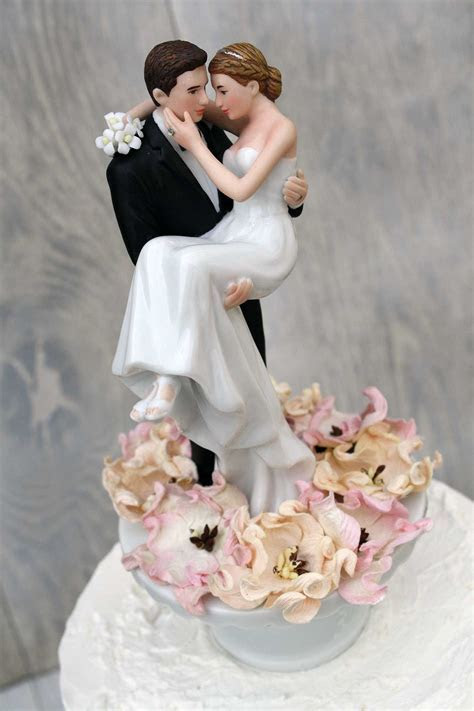 Bed of Roses Groom Holding the Bride Wedding Cake Topper