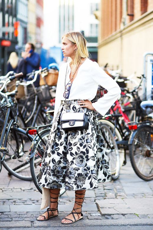 Le Fashion Blog Street Style Cfw Feminine Summer Look White Flowy Top Full Floral Print Skirt Two Tone Chanel Bag Lace Up Flat Sandals Via British Vogue