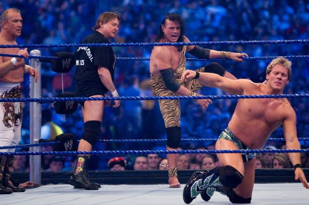 "Former professional wrestlers Ricky ""The Dragon"" Steamboat and ""Rowdy Roddy Piper look on as Jimmy ""Superfly"" Snuka steps into the ring to battle WWE Superstar Chris Jericho during WrestleMania 25"