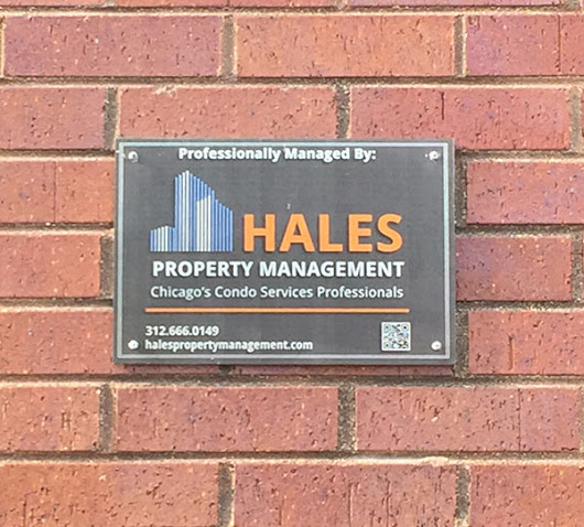 Why You See a Property Management Plaque on Every Chicago Building